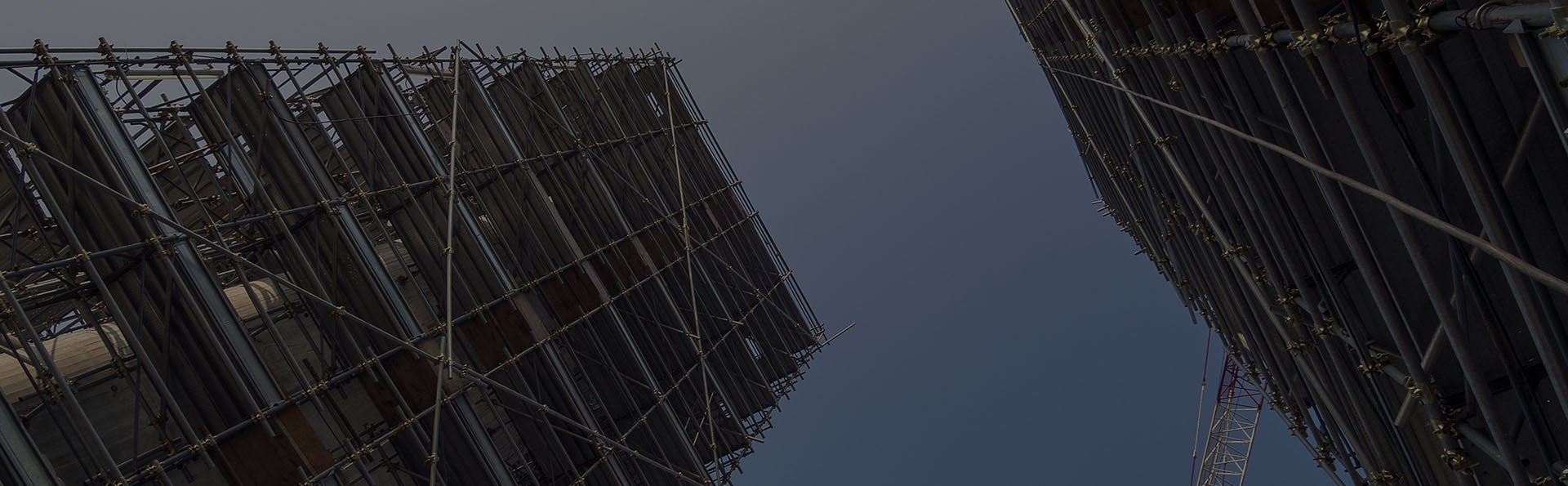 Erect scaffolding around two buildings