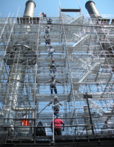 team of workers prevents scaffolding hazards