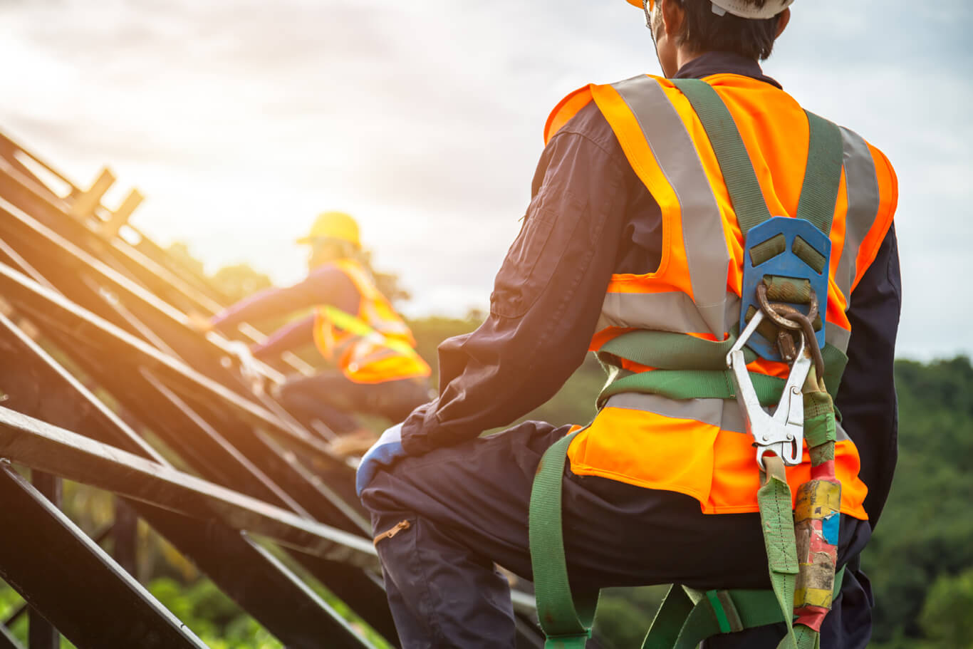 workers wear fall arrest systems per scaffolding safety guidelines