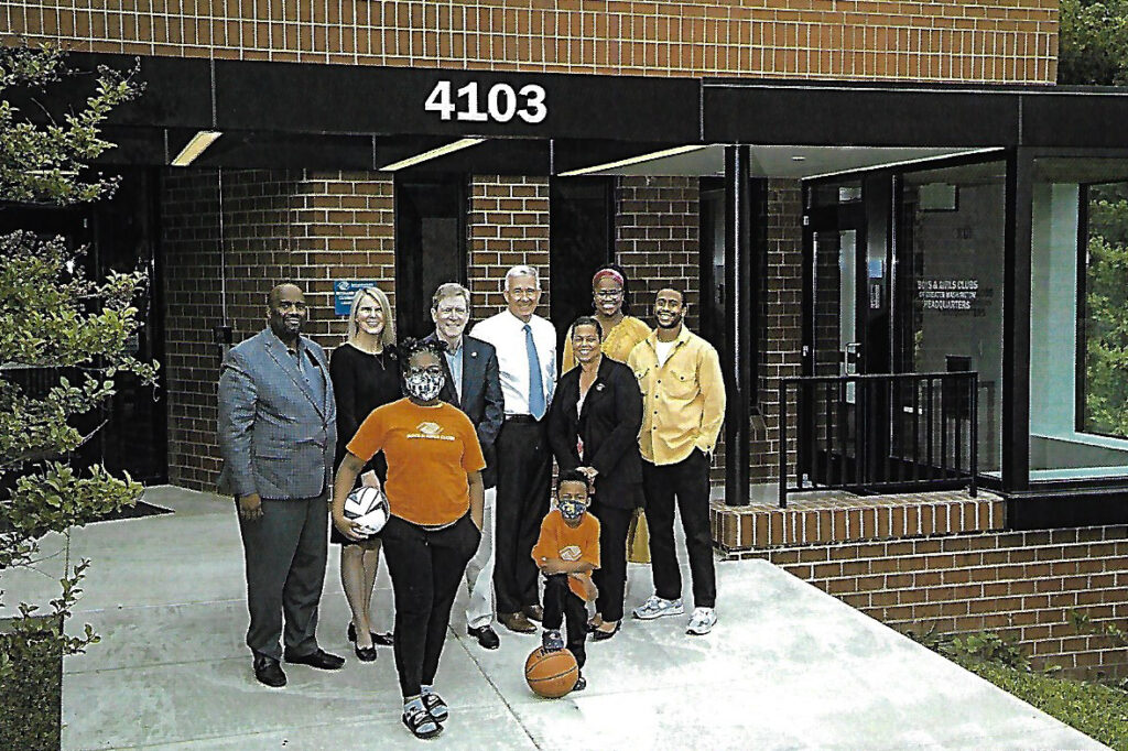 The leadership and two children in front of the newly renovated Headquarters of the Boys and Girls Clubs of Greater Washington